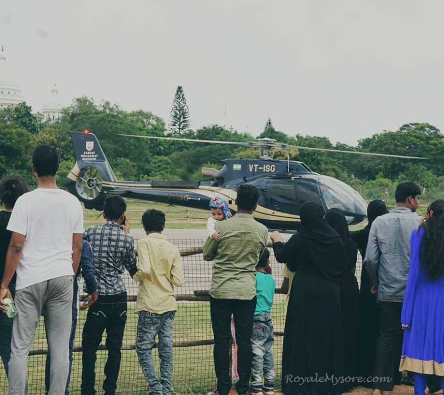People watching helicopter (Mysore Helipad)
